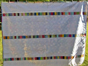 The beautiful back of Pat's Pinwheels quilt -- check out the quilting!