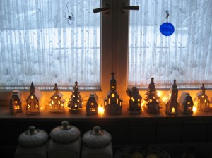 My little weisskirche (white church) collection glows warmly on the kitchen window sill with the wintry scene outside.