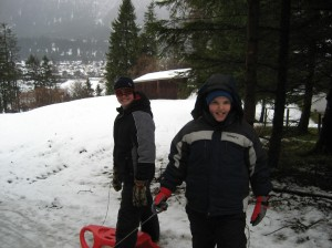 Even in the rain, the boys enjoyed some serious sled riding fun!