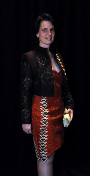 Birgit modeling her exquisite cocktail dress, jacket and coordinating clutch. Photo provided by Marilyn Karper.