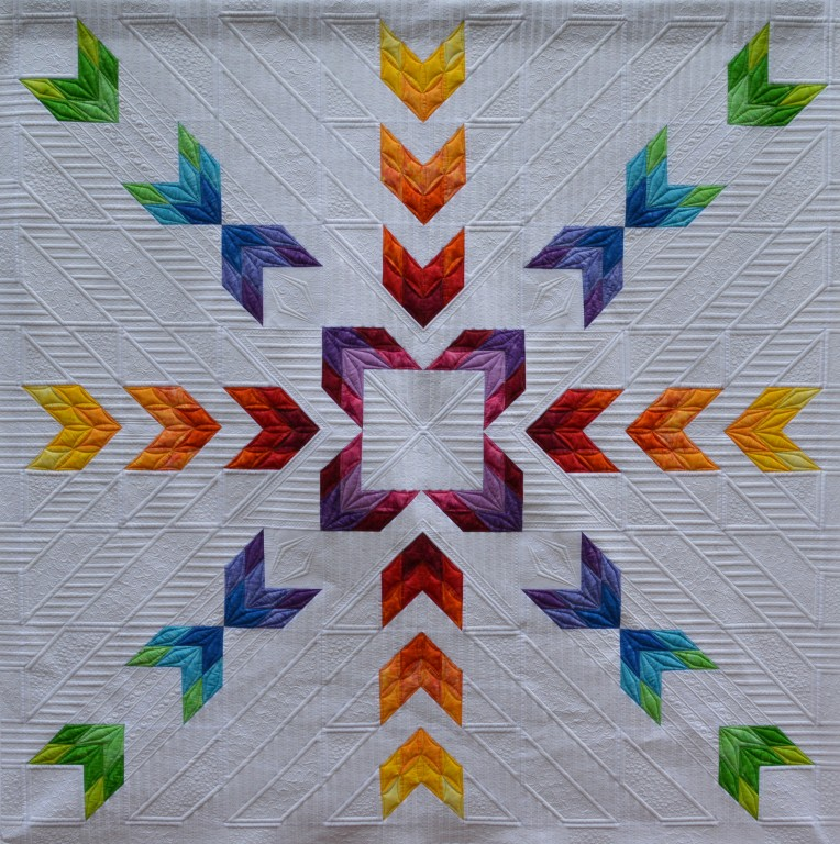 Designed and sewn by Kimberly Einmo. Exquisitely machine quilted by Judi Madsen, Green Fairy Quilts